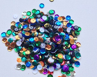 Multicolored sequins resin a hole, sewing, embellishment, knitting, decoration, crochet.