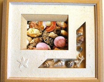 """""""Shells"""" with a card frame bra with real shells"""