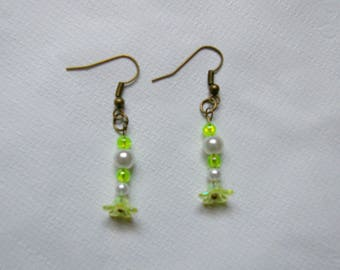bronze colored metal and white green earrings