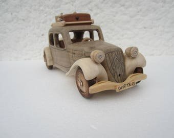 On the road. Wooden miniature of a Citroen traction before 11 CV car