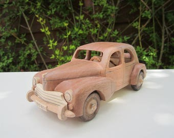 Wooden miniature of a Peugeot 203 Iroko 1/24 scale.