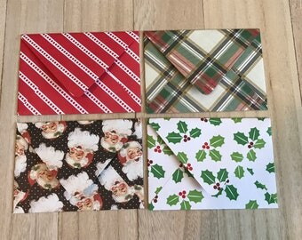 Four holiday lined envelopes with notecards