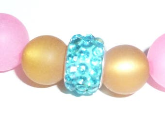 Pink-brown Polarisarmband with glass bead
