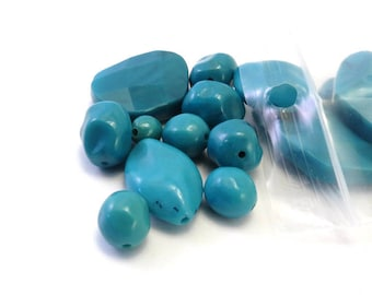 Assorted turquoise colored plastic beads