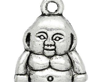 Small charm bearing the image of Buddha, open eyes