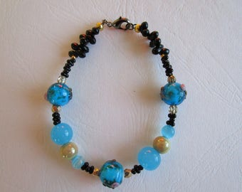 Blue Sky/gold and black lampwork beaded bracelet