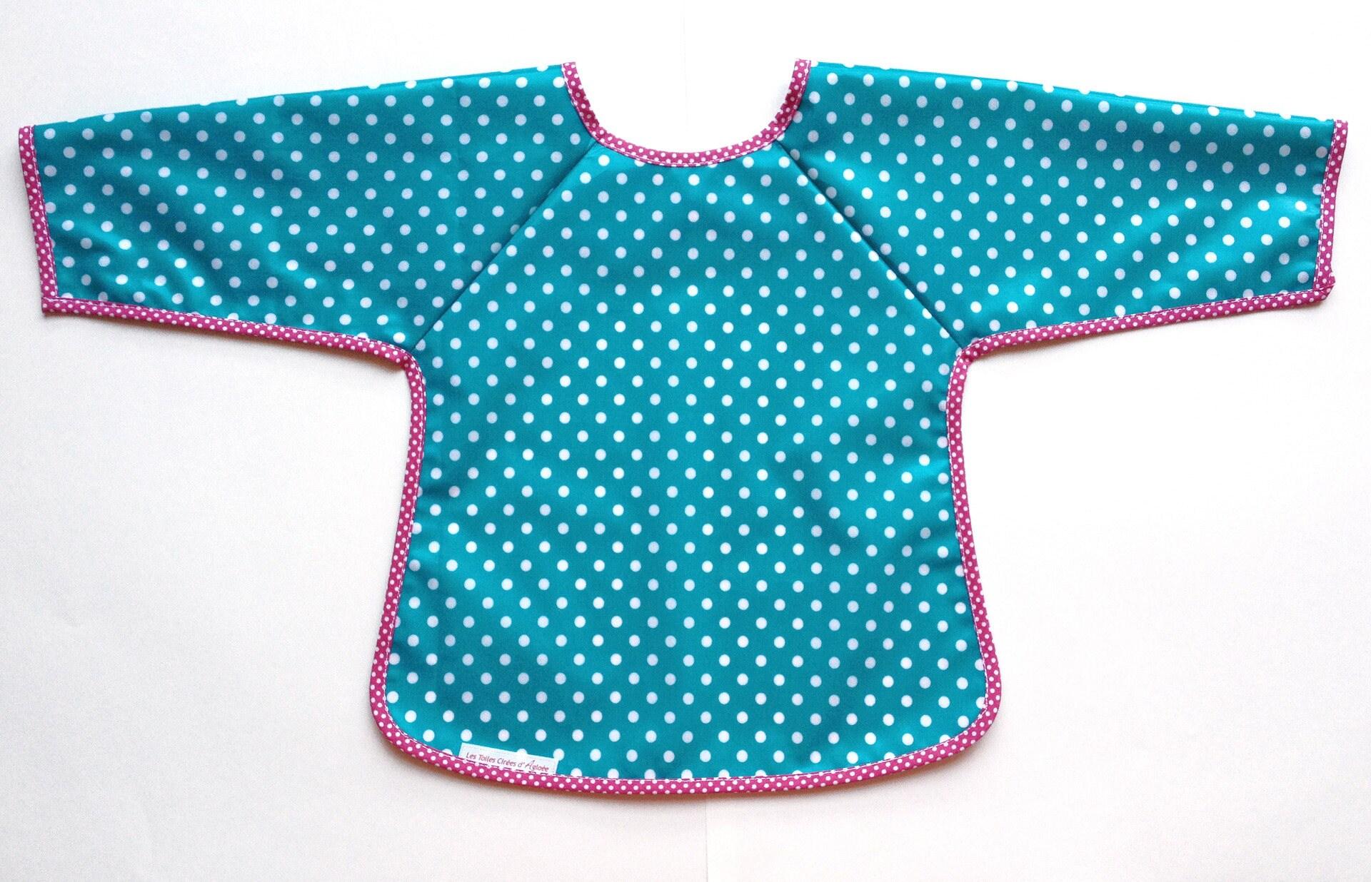 bavoir manches bleu turquoise a pois en tissu enduit enfant. Black Bedroom Furniture Sets. Home Design Ideas