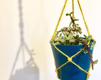 Handmade macrame plant hanger decorated with handmade ceramic baby owl bead. Boho decor.