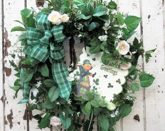 St Patrick's Day Greetings Wreath with Cream Mini rose, Orchid, Starflower and a Happy Leprechaun Plaque - Ready to Ship