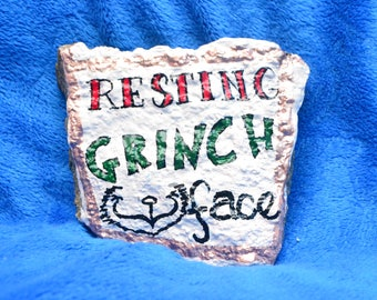 Resting Grinch face painted rock