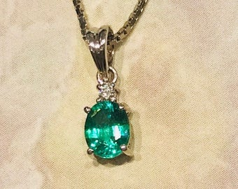 14 K White Gold 0.67 ct  Emerald  Diamond Pendant