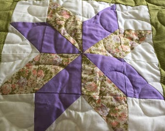 Star flower pieced quilt.