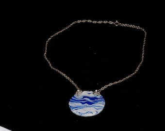 Necklace with blue and white polymer clay pendant
