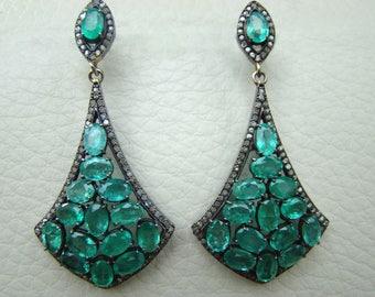 Emerald earrings of Victorian design.