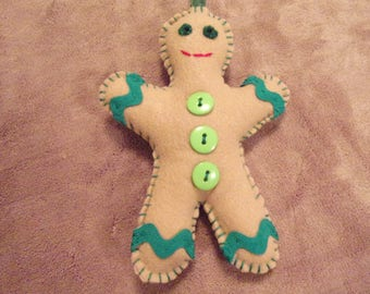 Gingerbread man, tan with green trim and buttons, Christmas ornament decoration