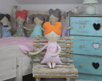 Handmade doll wearing a dress