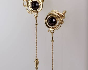 "Gold earrings with onyx ""Bull's eye"""
