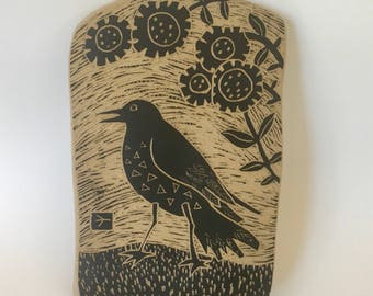 crow on a summer day hand carved ceramic art tile