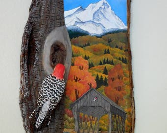 Covered Bridge Shallow Relief Wall Hanging with a three dimensional, detailed carving of a Red Bellied Woodpecker