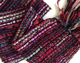 handwoven scarf with black and red ribbons