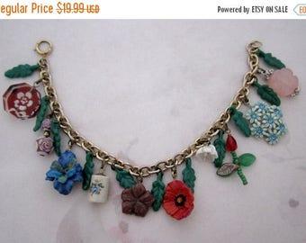 ON SALE- handmade flower themed charm bracelet w vintage components - j6238