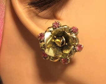 Vintage Clip On Rose Earrings with Pink Rhinestones and Gold Colored Metal Settings. They Measure About 7/8 of an Inch in Diameter. (D15)