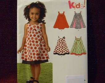 Uncut New Look Pattern 6974 Pretty Dress for Baby and Toddler