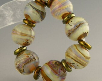 handmade lampwork glass bead set of 7 translucent rounds done in silverglass and encased in clear - Nacre