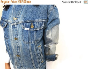40% OFF The Vintage Lee Light Wash Silver Metallic Foil Sleeved Jean Jacket