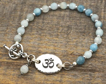 Light blue om bracelet, Tibetan Zen jewelry, faceted aquamarine beads, semiprecious stone, 7 3/4 inches long
