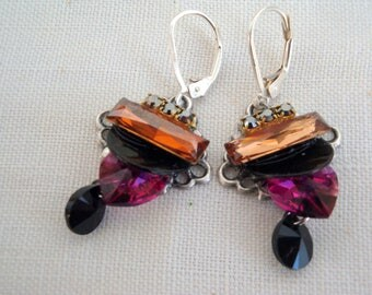 Full and mother of Pearl Crystal earrings