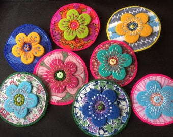 Daisy brooch - various colours made with felt and vintage fabric . beads and embroidery