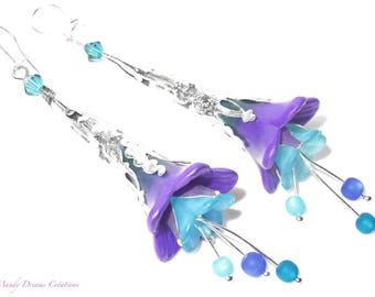 Romantic bohemian sleepers, violet and light blue lucite flowers, lagoon crystal tops.