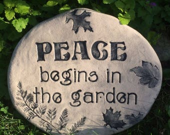 PEACE sign. PEACE begins in the garden. Inspirational stone with saying / Ferns, Woodland leaves. Handmade ceramic outdoor plaque