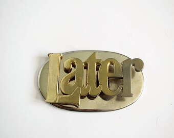 Mid century brass clip/ saying LATER/ desk accessory