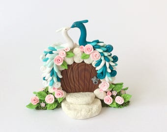 Teal and white peacock themed wedding cake topper handmade from polymer clay