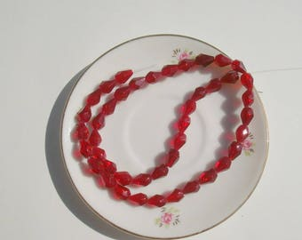 213 - Set of 10 dark red faceted glass drop beads
