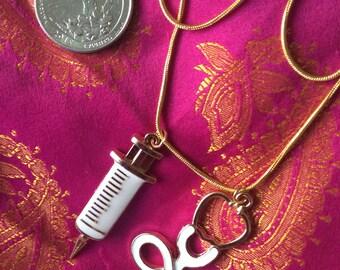 Necklace medical syringe goldtone metal painted white
