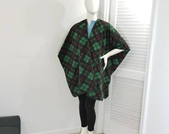 Green, black and red plaid fleece wrap