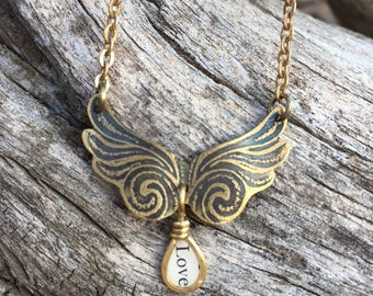 etched brass metal angel wing wings wire wrapped charm necklace jewelry resin bezel inspirational sayings wild mixed media jewelry