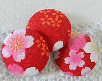 Red floral fabric button, 32 mm in diameter