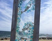 Mermaids swimming in a sea of beach glass panel