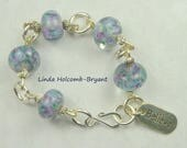 "Silver Bracelet of Violet and Blue Lampwork Beads with ""Believe"" Charm"