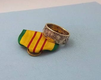This is a Vietnam service medal turned into a size 10  ring.