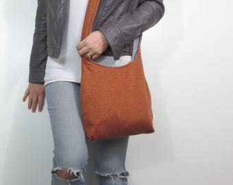 on sale and ready to ship orange sweater crossbody hobo bag.