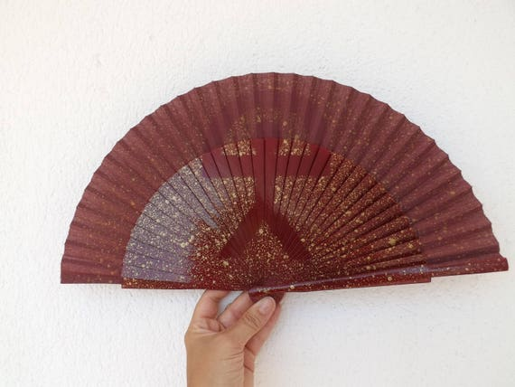 Indalo symbol Brown Gold Hand Fan