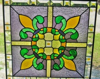 "Fleur-de-lis stained glass panel 14.5"" x 14.5"" with beveled border"