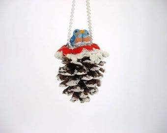 Ornament, pine cone ornament, decorated miniature pine cone with ceramic baby love bluebirds
