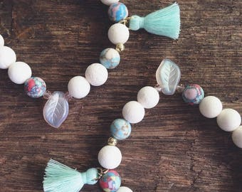 Unicorn inspired bracelet White and Mint green beads mint tassel pastel color beads opalescent leaf beads EstuJewelry Unicorn arm candy
