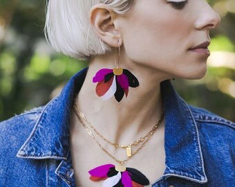 Black Magenta Feather statement earrings by Pardes